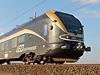 Černo-zlatá souprava nového železničního dopravce Leo Express