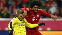 Fotbalista Bayernu Mnichov Dante (vpravo) a Jakub Blasczykowski z Borussie Dortmund | na serveru Lidovky.cz | aktu�ln� zpr�vy