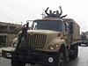 Bojovn�ci ISIL oslavuj� sv� vit�zstv� v Mosulu v autech uko�ist�n�ch uprchl�m...