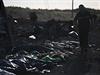 Záchranáři našli do nedělního večera na místě pádu letadla malajsijských aerolinek na východní Ukrajině již 251 těl a 86 jejich částí.