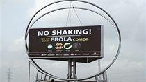 Plakát varující p�ed ebolou v nigerijském Lagosu. Slogan hlásá �net�este si... | na serveru Lidovky.cz | aktu�ln� zpr�vy