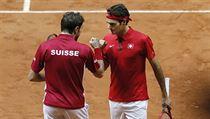 Finále tenisového Davisova poháru Francie - �výcarsko: Wawrinka (vlevo) a... | na serveru Lidovky.cz | aktu�ln� zpr�vy